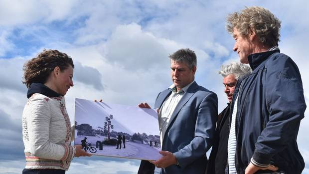 Artist Amy Lynch (left), Simon Tremain, managing director of Tremains, and artists Jacob Scott and Riks Terstappen view the illustration of Elixir of Life.