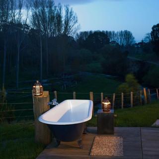 Outdoor bath at night - Kowhai Retreat