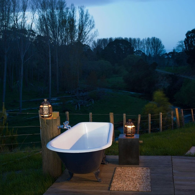 Outdoor bath at night - Kowhai Retreat