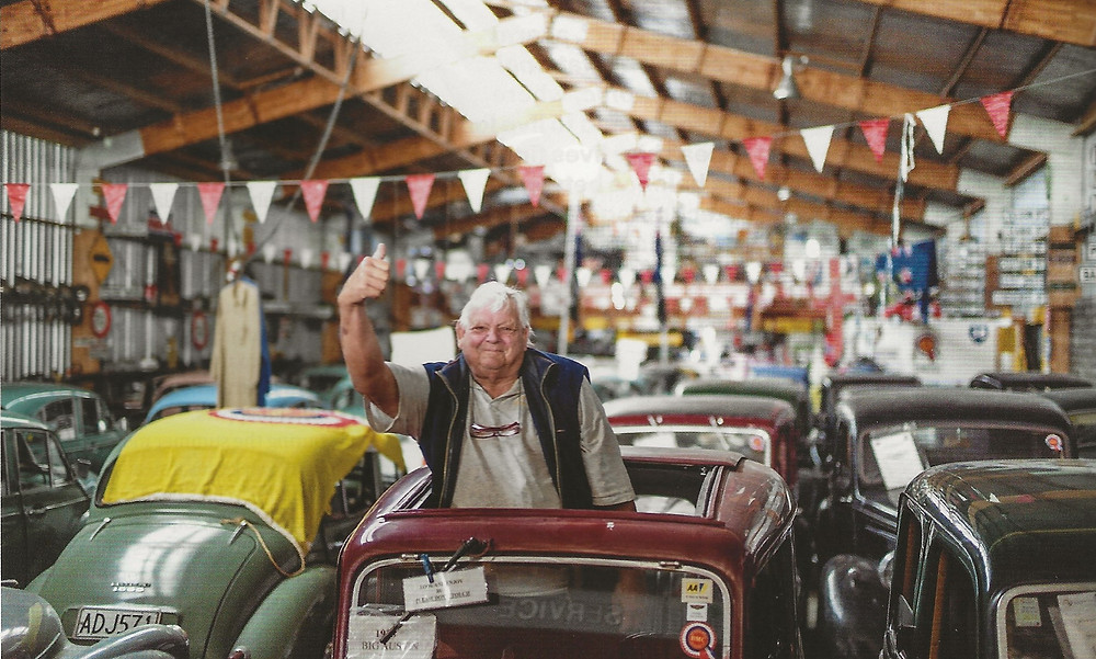 Ian Hope inside his British Car Museum, surrounded by Morris Minors