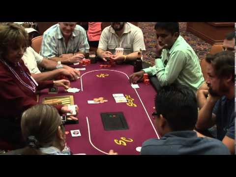 People playing poker at a casino table