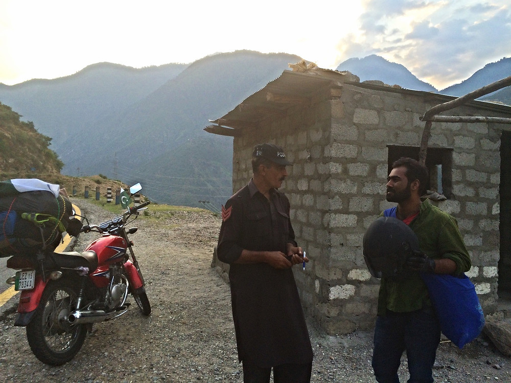Friendly Police at checkpoint along the Karakoram Highway.