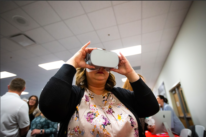 Community member trying out an AR/VR experience