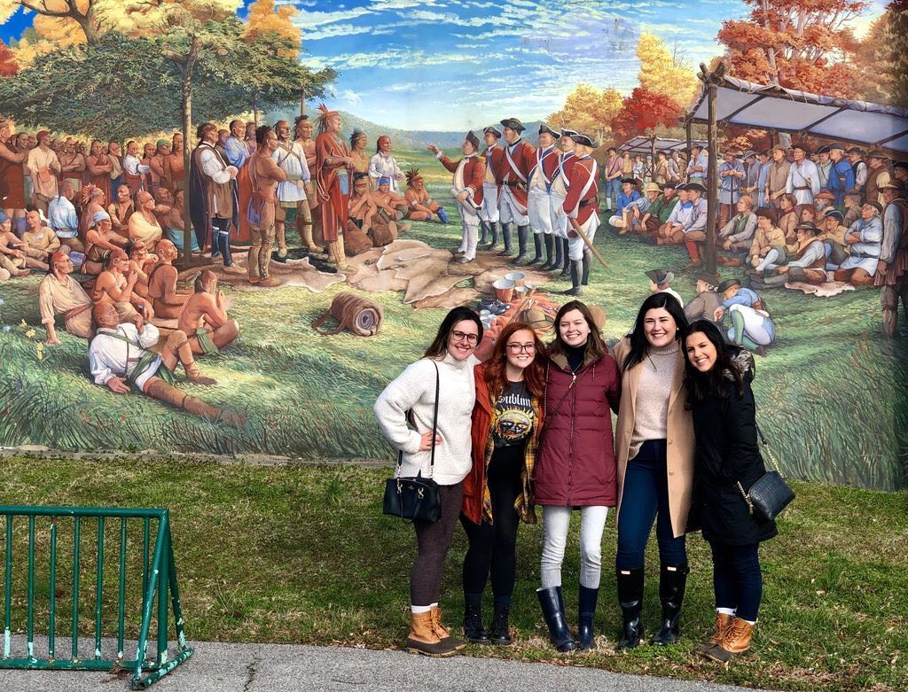 Some of the BrandJRNY students in front of the Murals at Riverfront Park