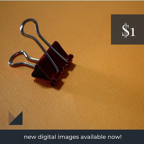 Digital Web Graphic | Black Paper Clip (Orange Background) | Photography