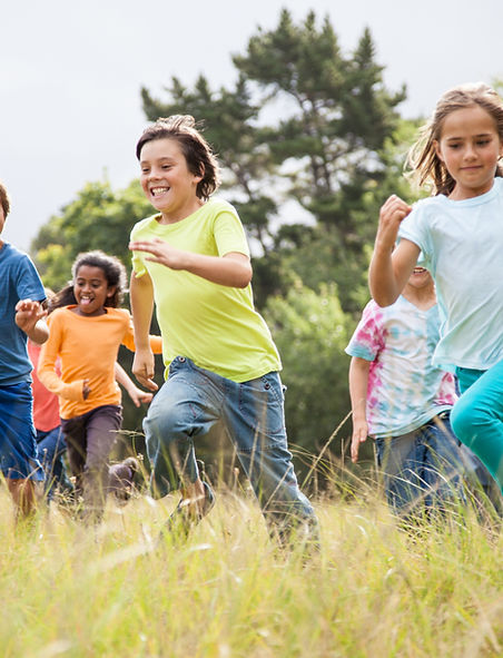 happy children running in a field