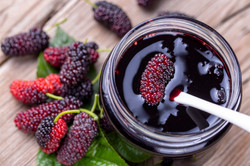 Domestic fresh mulberry jam on a rustic