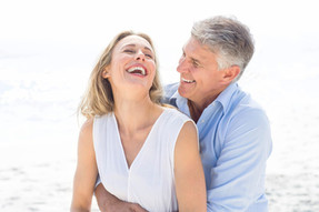 happy-couple-laughing-together-beach-sex