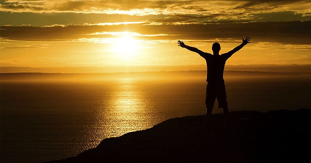 14462-sunset-mountain-silhouette-person-arms-raised-social.1200w.tn_.png.jpg
