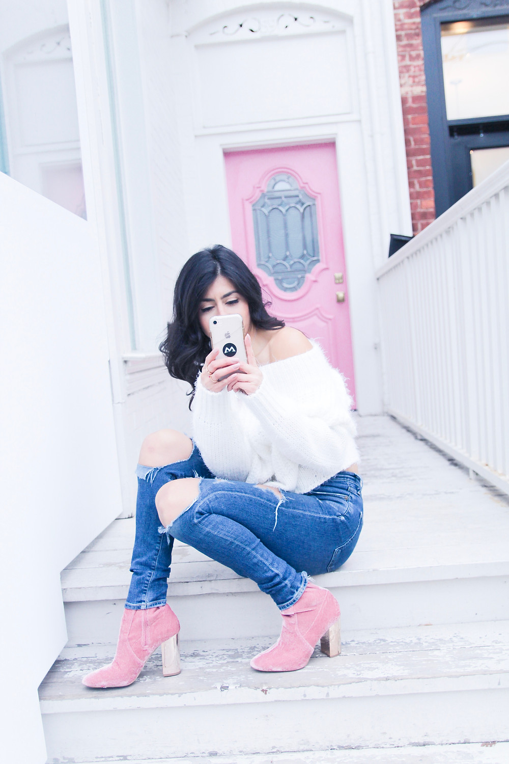 that single mom charlene lizette spanish female by a pink door wearing pink boots and blue jeans and white top on her phone