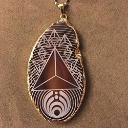 for the awesomest _dandylion_design _#goldplated #laseretched #agate _#tetrahedron #fire #platonicso