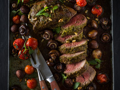 ROASTED MARINATED FILLET, PORTABELLINI MUSHROOMS AND VINE TOMATOES WITH PESTO
