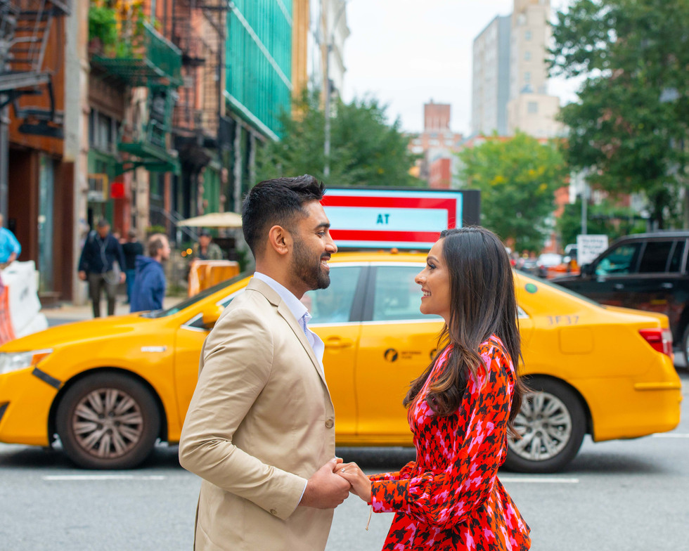 NYC Engagement Photographers Classic Taxi shot