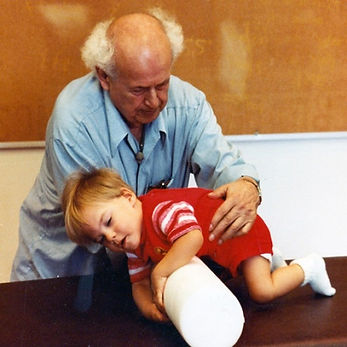 MOSHE-Feldenkrais-working-with-child-1-n