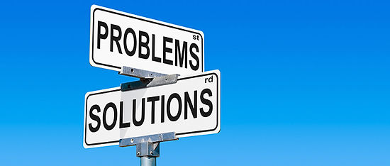 """Road signs with """"Problems"""" and """"Solutions""""."""