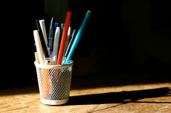 Pencils and Pens in Cup