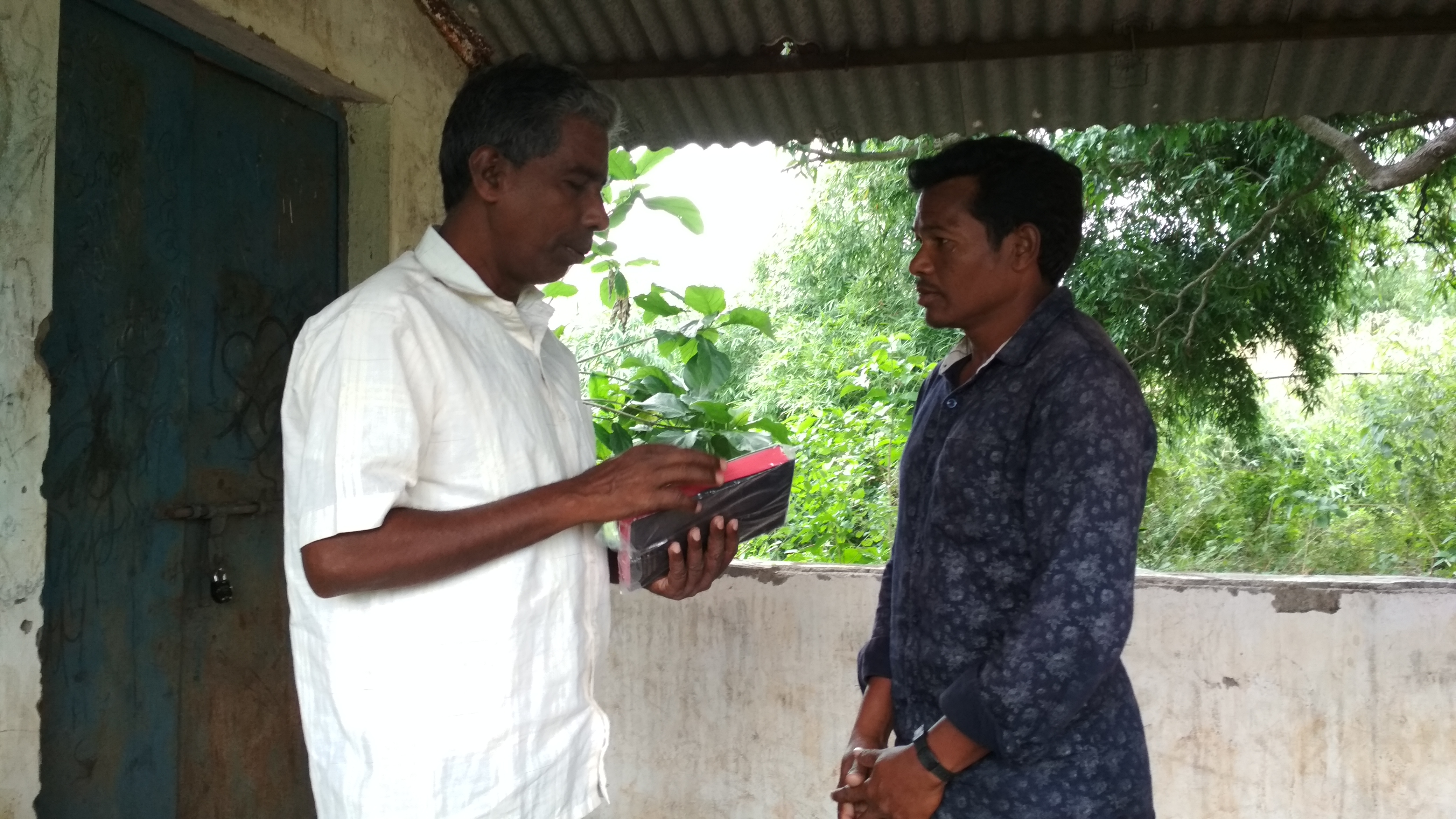 Lachhana receives Bible from Hanok Karad