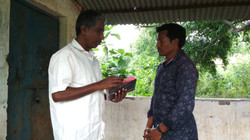 Lachhana receives Bible from Hanok Karad