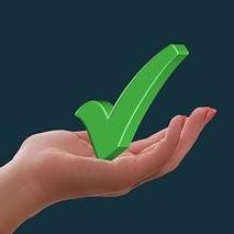 Hand holdig a green tick