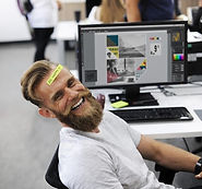 Laughing woker at a desk