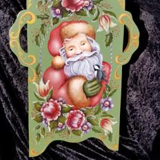 4. Hand-Painted Santa Sled Decor