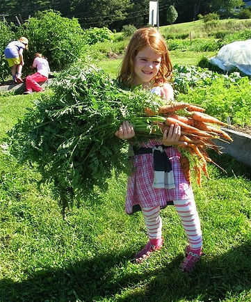 Copy of Maggie Moore with Carrots.jpg