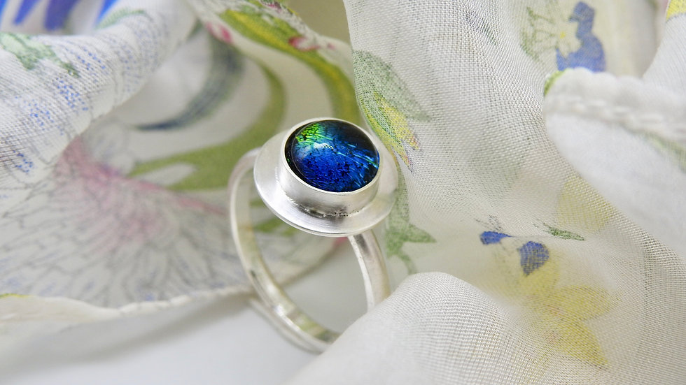 Blue dichroic stone with contemporary setting