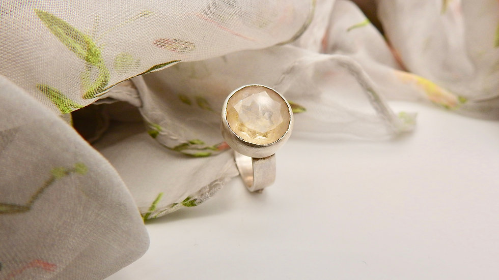 Silver statement ring with golden rutile gemstone