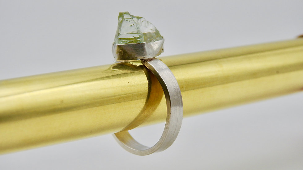 Beautiful rough green amethyst in contemporary silver setting