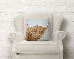 Highland cow cushion and chair.jpg