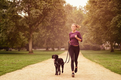 Woman Running with Dog