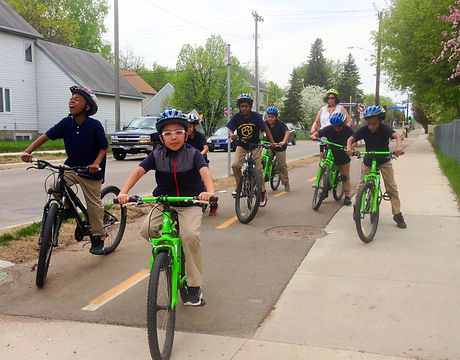 Children riding on 26th Avenue N trail