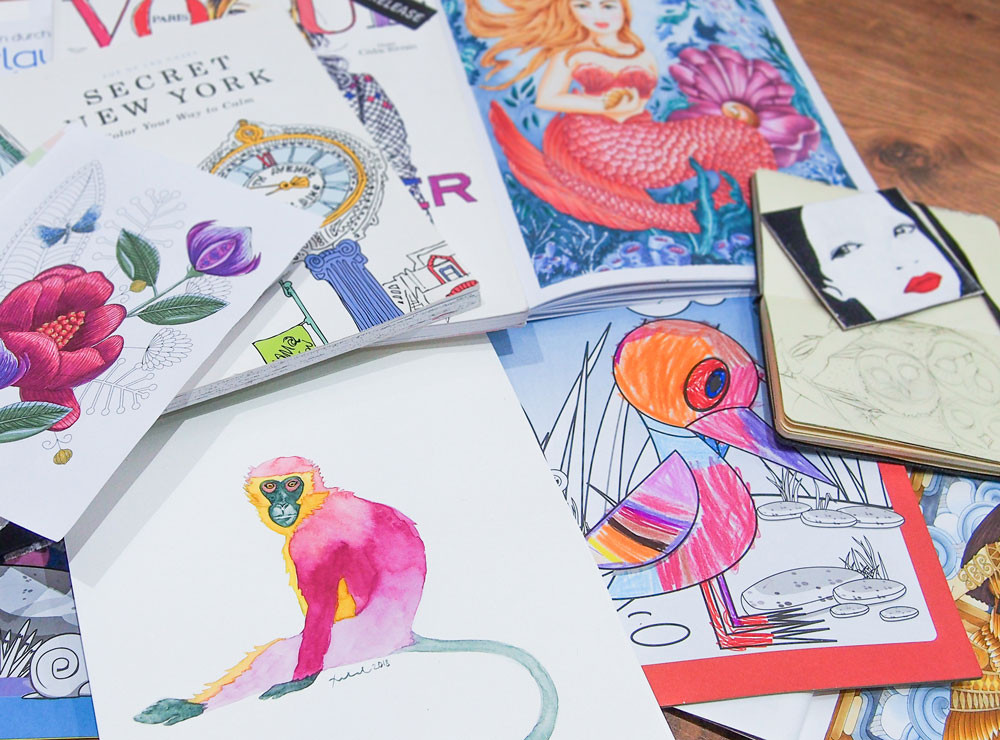 A collection of coloring books and colorful artworks