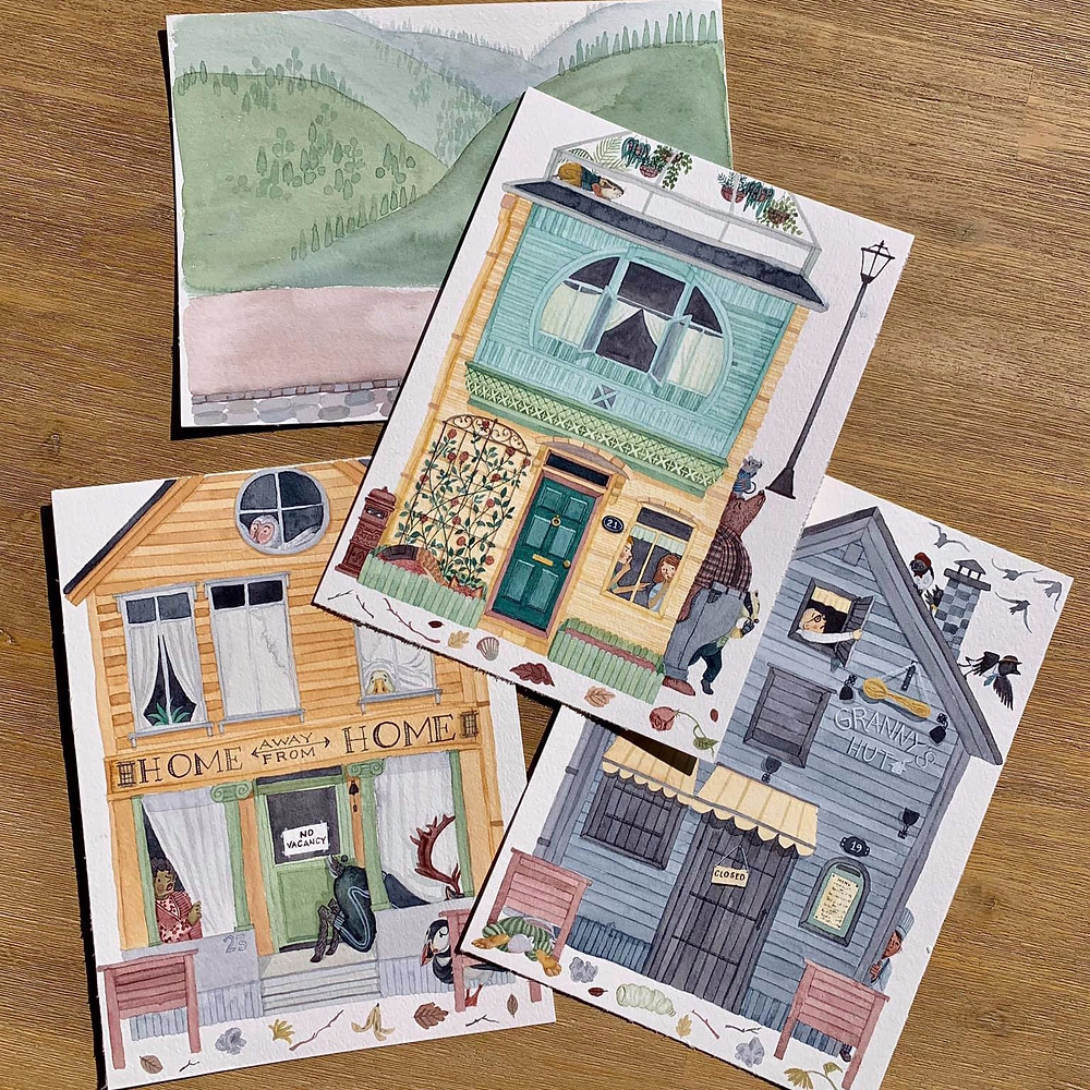 illustrated houses on a wooden table