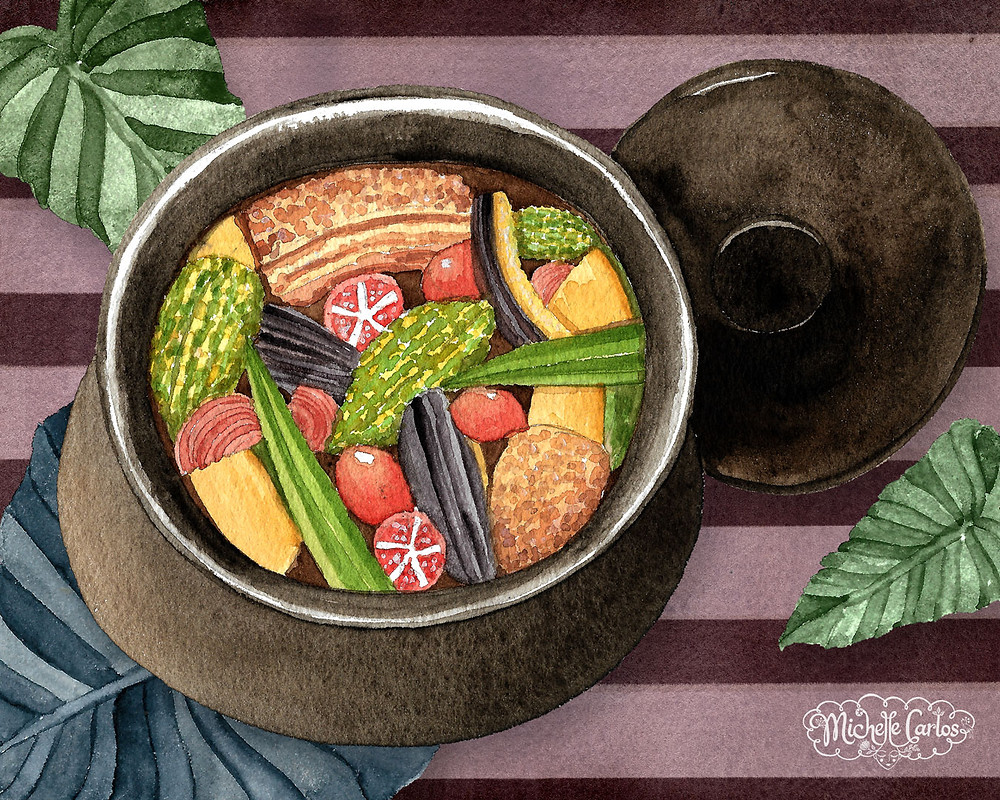 a clay pot with cooked vegetables