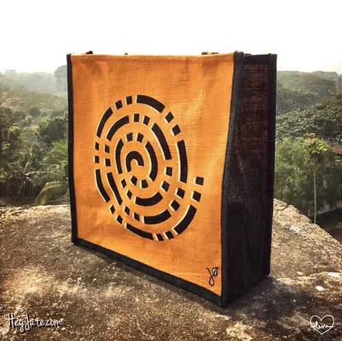 Orange and Black HeyJute Jute Tote bag with swirl pattern