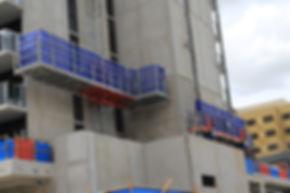 Mast Climber cofigured around building