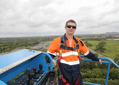 A person up high in a boom lift
