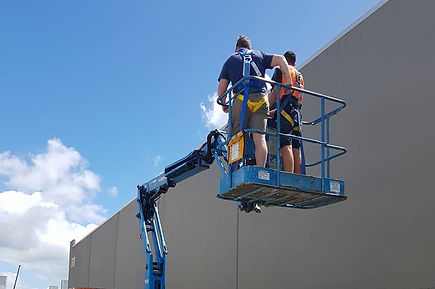People training on boom lift in warehouse environment