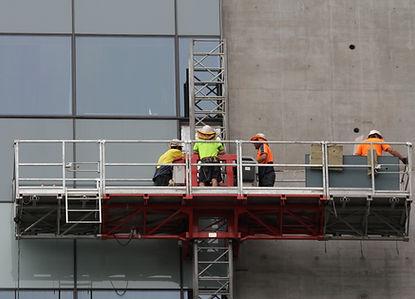People working on Mast Climber platform