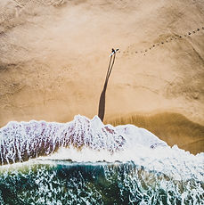 Canva - Person Walking Near Shore.jpg