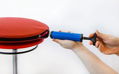 Pump for ergonomic air cushion