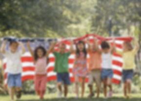 Kids running with flag1.jpg