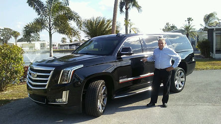 Cadillac SUV black with Joe.jpg