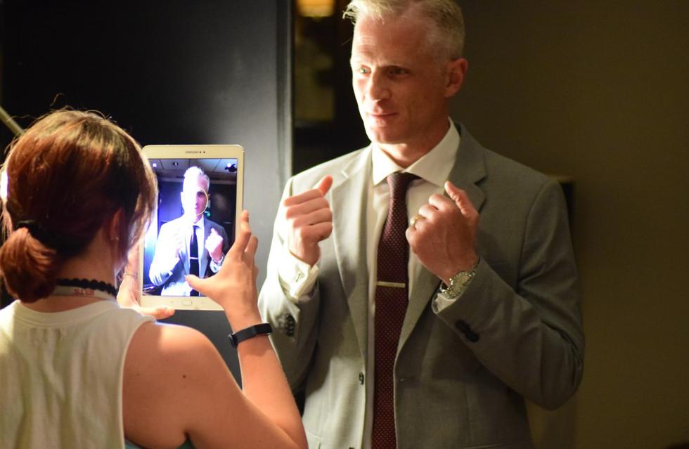 Script supervisor Nieves snaps a photo of John Halloran
