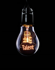 Hanging lightbulb with glowing Talent co
