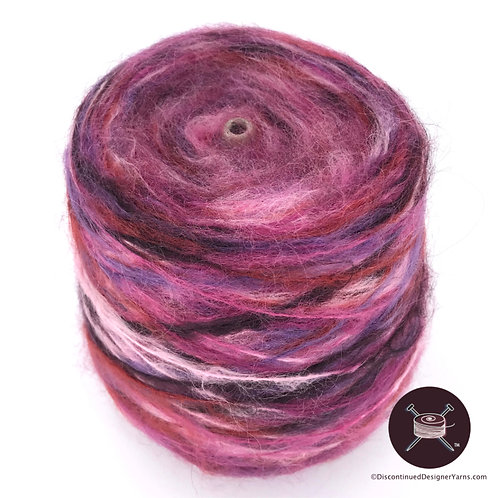 Cone of space dyed mohair yarn