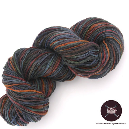 Dark teal, brown, amber ribbon yarn
