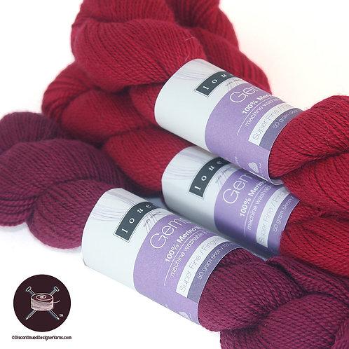 cherry red and burgundy fingering weight merino yarn
