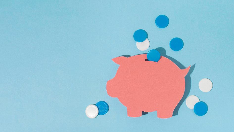 top-view-piggy-bank-blue-background.jpg